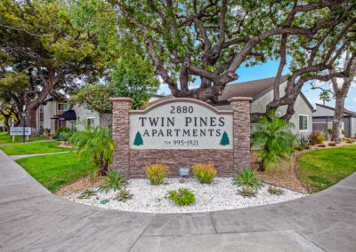 Twin Pines apartment sign